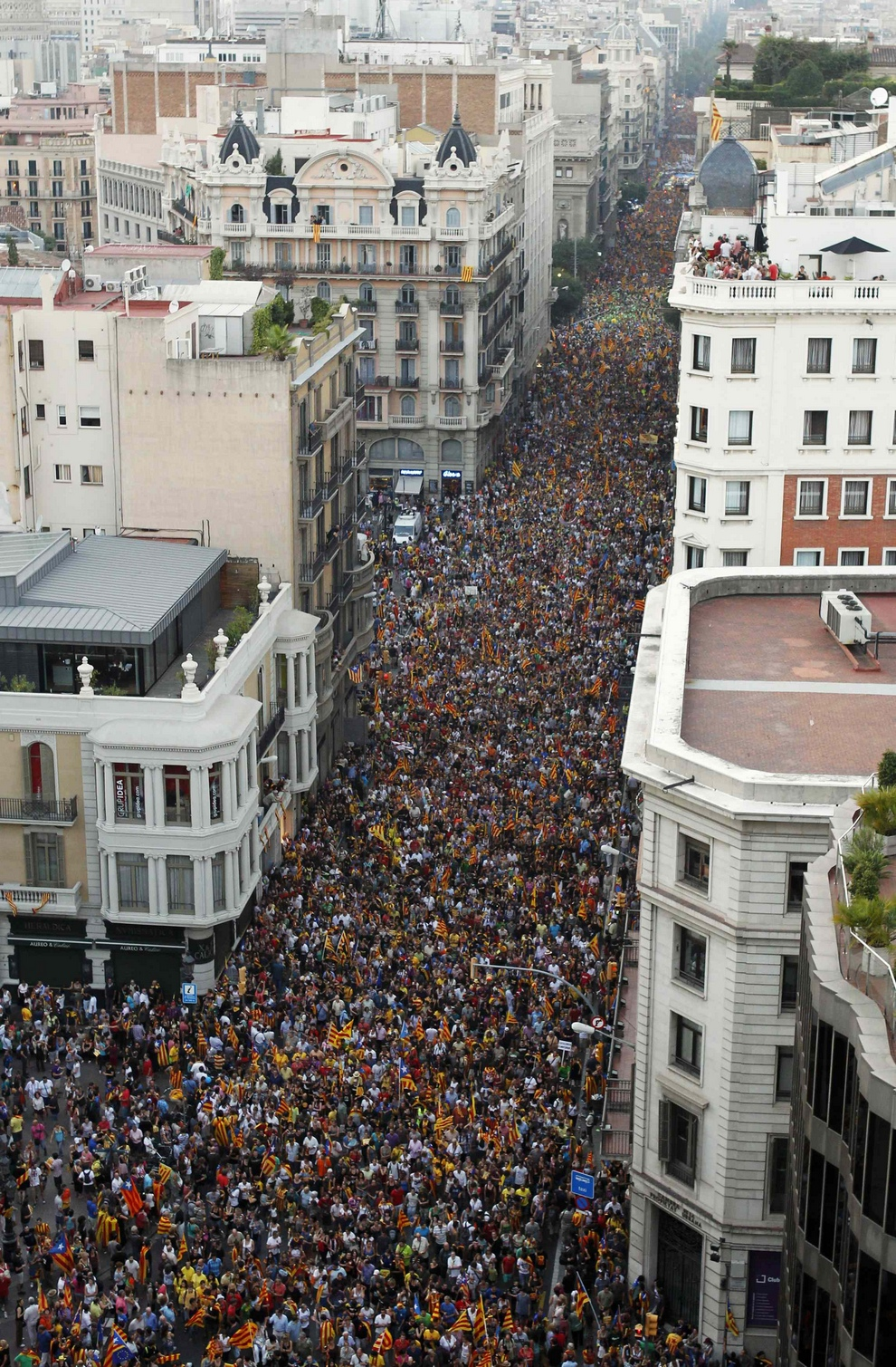 Marchers demonstrate during Catalan National Day in Barcelona