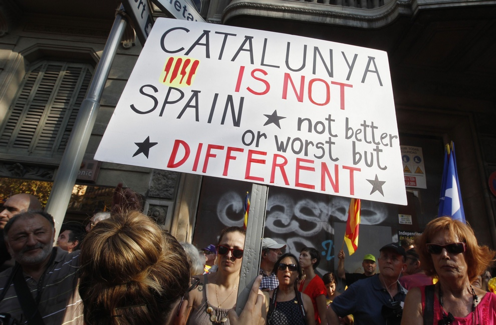 A marcher holds a placard during a demonstration on Catalan National Day in Barcelona