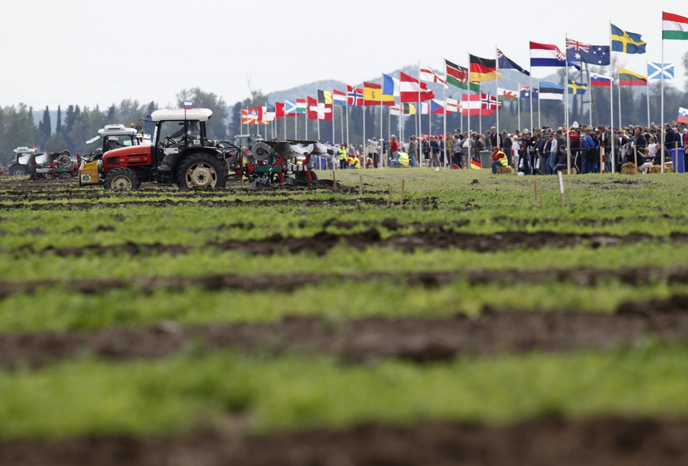 Competitors plough during World Ploughing Championship in Vrana