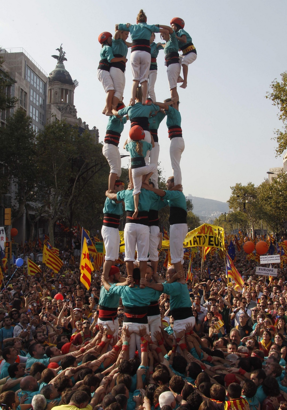 "A group of Castellers form a human tower called a ""Castell"" during a demonstration on Catalan National Day in Barcelona"