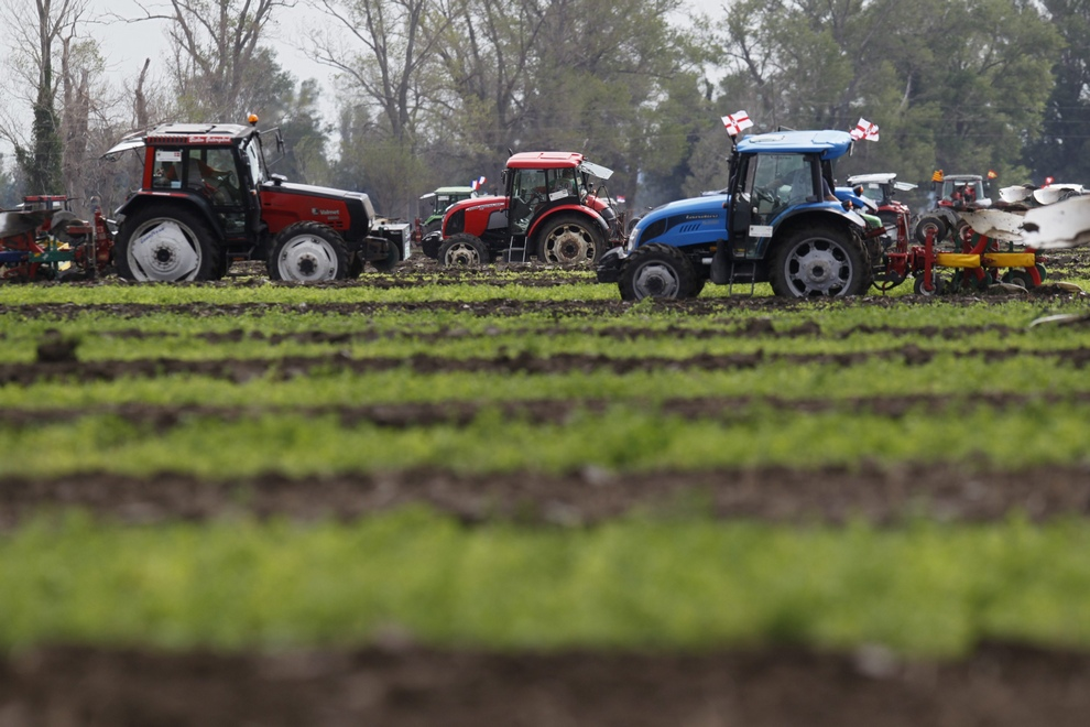 Competitors drive their tractors during the World Ploughing Championship in Vrana