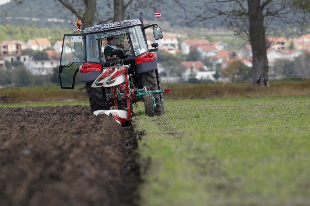 Competitor representing the United States drives his tractor during the World Ploughing Championship in Vrana