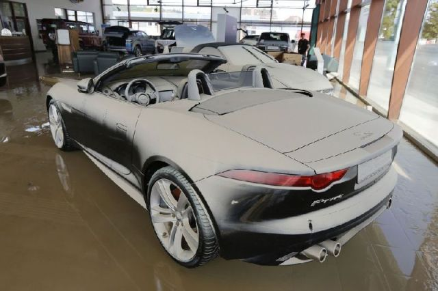 A brand new Jaguar F-Type convertible stands in a showroom covered with a thin film of mud after the floods of the nearby Danube river subsided in Fischerdorf
